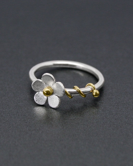 Silver daisy ring with brass tendrils