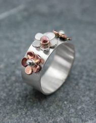 Three flower ring in silver and copper