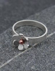Silver flower ring with copper detail