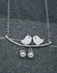 Two bird pearl necklace