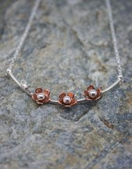 silver and copper daisy necklace with mouse
