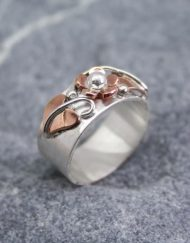 Sterling silver flat band ring with copper flower and leaves