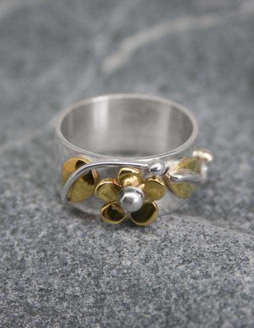 Silver ring with brass flower and leaves