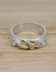 Sterling silver ring with brass detail
