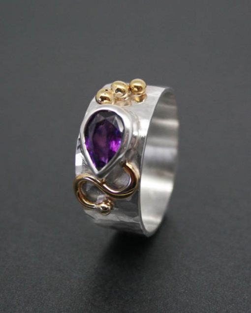 Pear shaped amethyst silver ring with brass detail