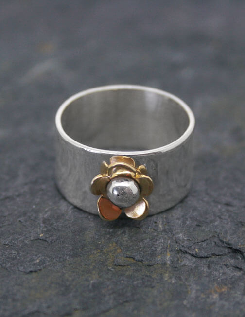 Wide sterling silver ring with brass daisy and silver bead 1