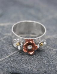 Silver ring with copper and brass flowers | Starboard Jewellery