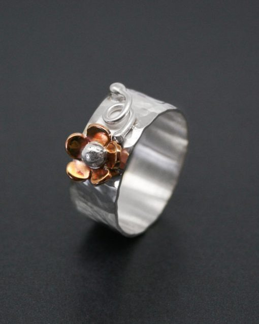 Sterling silver band ring with copper daisy and silver detail