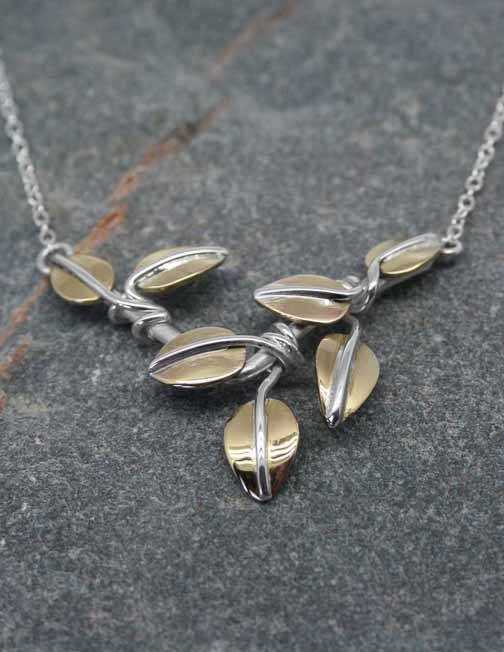 Silver pendant with brass leaves