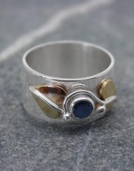 Sterling silver and sapphire ring with brass leaves