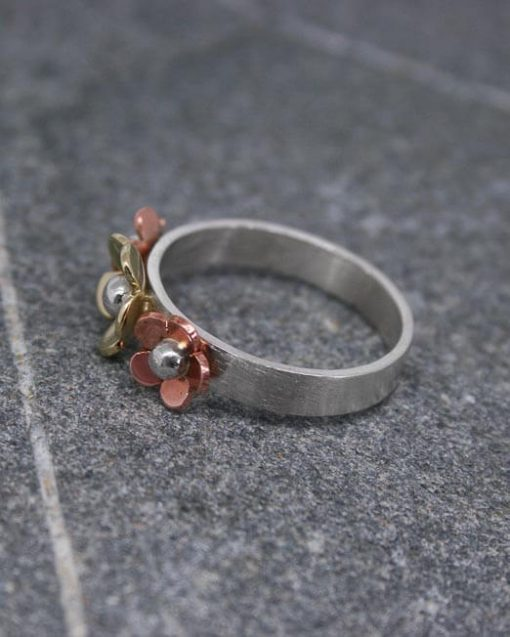 Floral ring in sterling silver and mixed metal 1