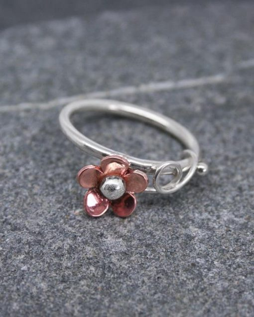 Silver ring with copper daisy