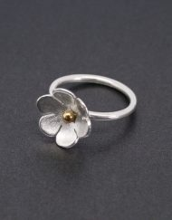 Silver flower ring with brass center
