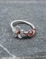 Silver daisy ring with copper tendrils