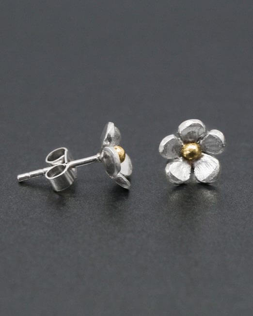 Silver-and-brass-flower-studs-side