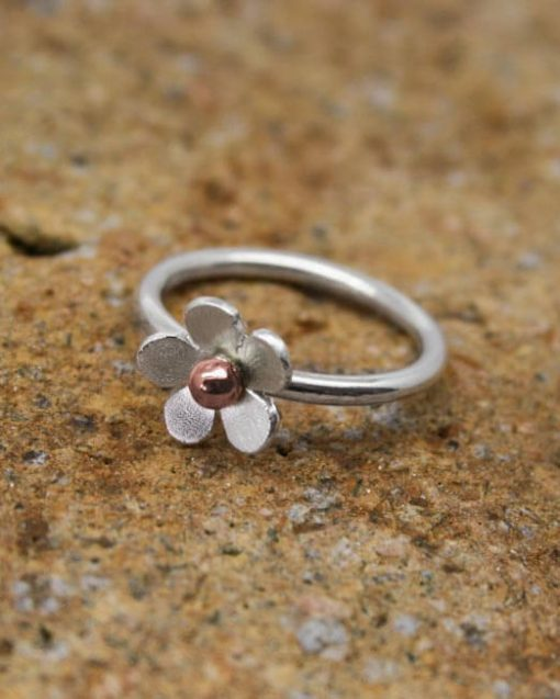Handmade Silver flower ring with copper bead
