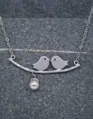 Two birds on a branch necklace with pearl drop