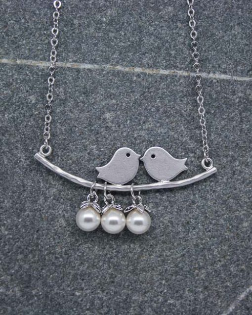Two birds on a branch necklace with pearl drops 1