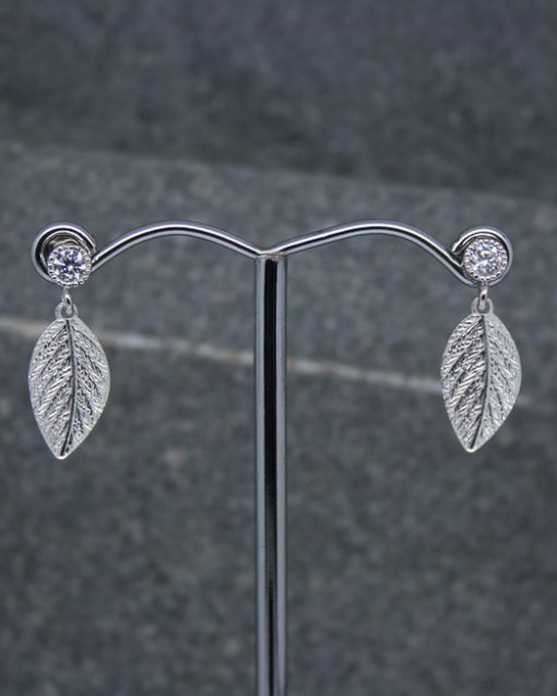 Crystal and leaf stud earrings 1