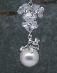 Floral pearl drop and hummingbird earrings
