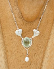 Art nouveau style silver necklace set with a phrenite cabochon and pearl