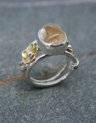Cabochon rutilated quartz silver ring with bronze and brass detail