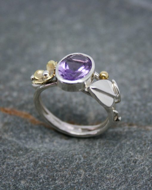 Handmade amethyst and silver ring with brass flower and silver leaf