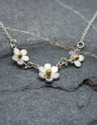Handmade silver and brass three flower daisy necklace