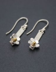 Handmade silver daisy drop earrings with brass centres on hook fittings