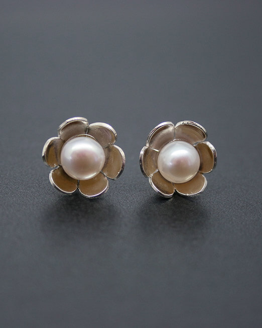 c757f9db1 Silver daisy stud earrings with fresh water pearls. £42.00. 🔍. Silver and  pearl flower earrings