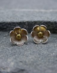 Silver daisy earrings with brass centres