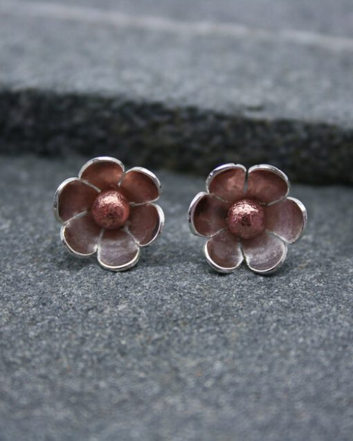 Silver daisy earrings with copper centres