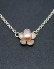 Single silver flower and pearl necklace