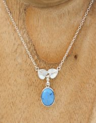 art nouveau style silver and turquoise necklace with leaf detail