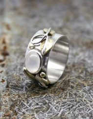 silver and moonstone ring with brass leaves and silver wire detail