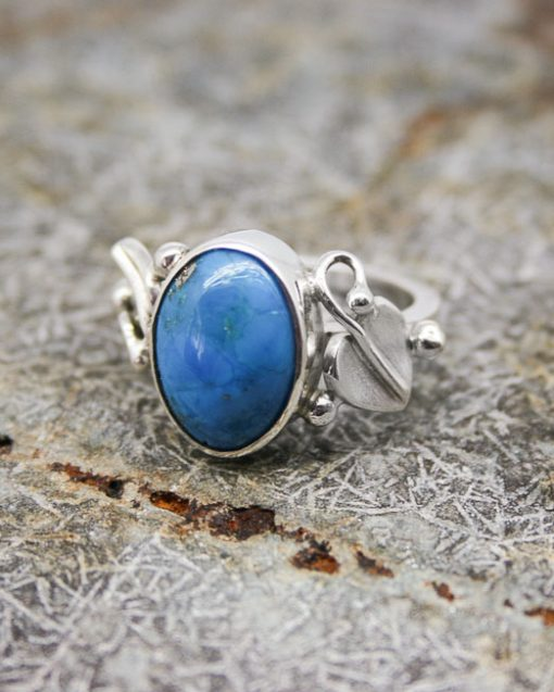 silver and turquoise ring with leaf shoulders