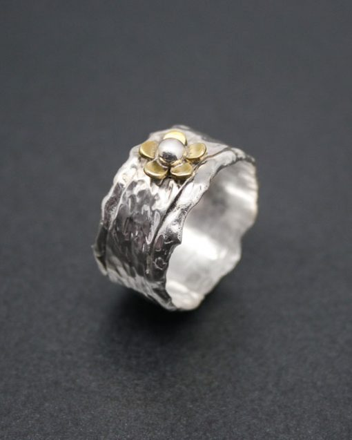 Wide sterling silver ring with flower and silver detail 1