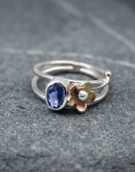 Silver Iolite ring with brass flower detail