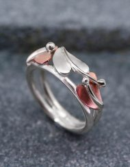 Silver and copper three leaf ring