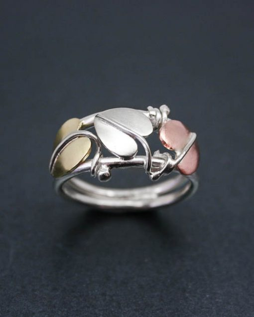 Silver, copper and brass three leaf ring
