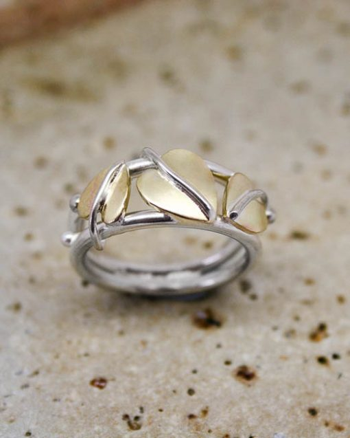 Silver ring with three brass leaves
