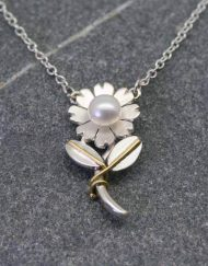 Pearl and silver flower pendant Necklace with stalk and leaves