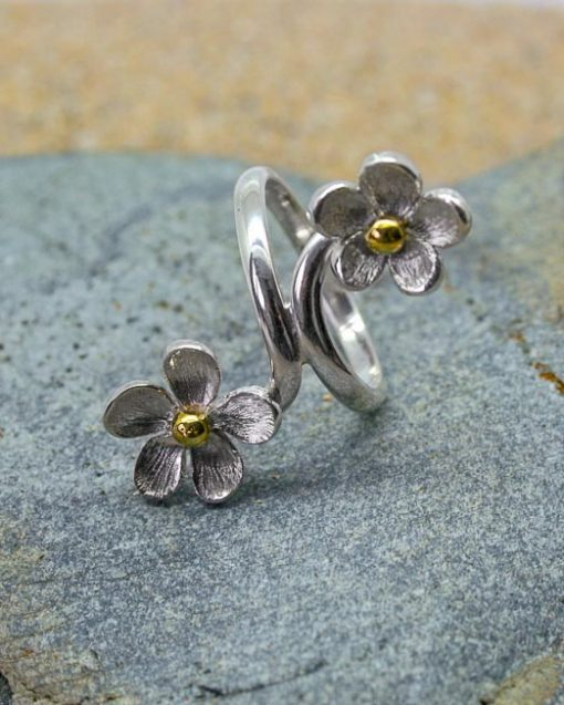 Silver daisy crossover ring with silver, copper or brass centres