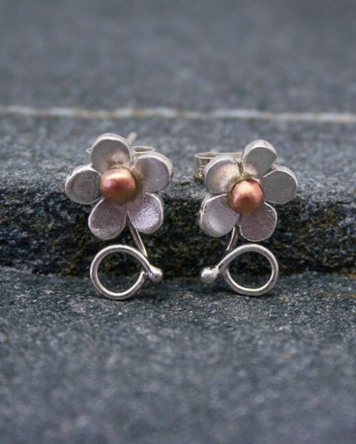 Handmade silver flower studs with copper or brass centres