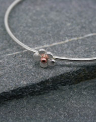 Sterling silver bangle with flower and bead