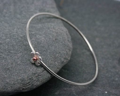 Sterling silver bangle with flower and bead 1