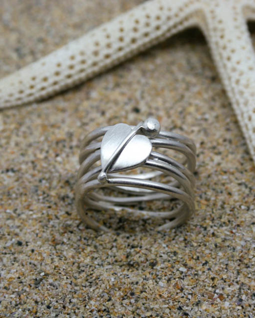 Wide sterling silver roller coaster ring with unique heart shaped leaf